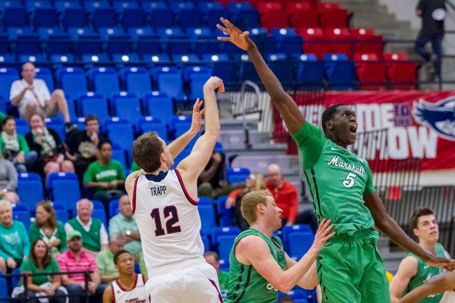 Jackson Trapp (12) shoots over Cheikh Sane's (5) to attempt a 3-point shot.