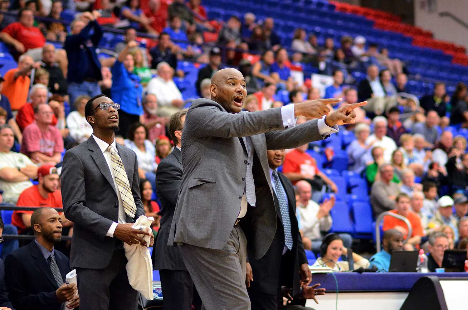 Head coach Michael Curry directs his team during the final minutes of Saturday night's victory over Marshall.