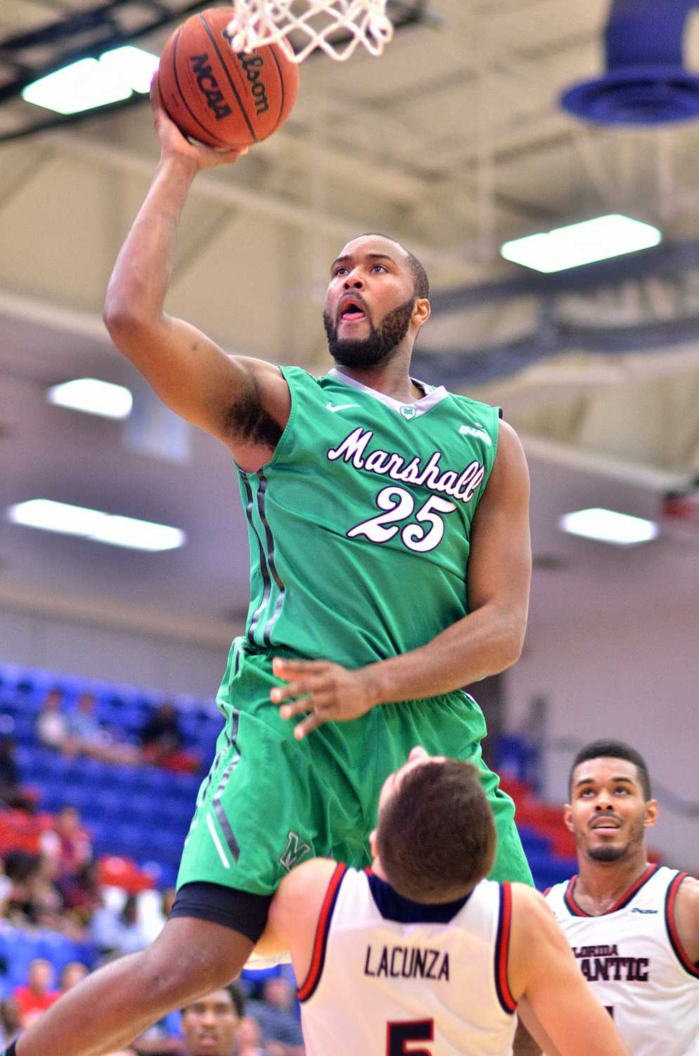 Marshall forward Ryan Taylor (25) cruises to complete a layup against FAU forward Javier Lacunza (5). Taylor led the Thundering Herd with 24 points.