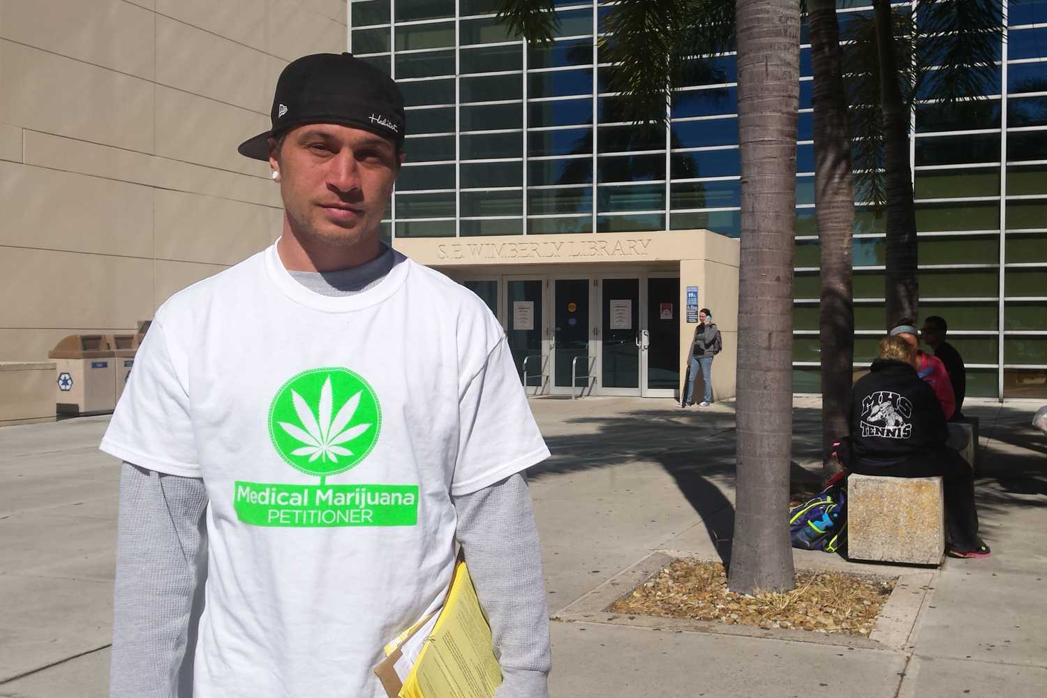 Mike McSherry collects signatures for petitions to place medical marijuana and solar power initiatives on the 2016 election ballot in Florida. Photo by Dylan Bouscher   Contributing Photographer