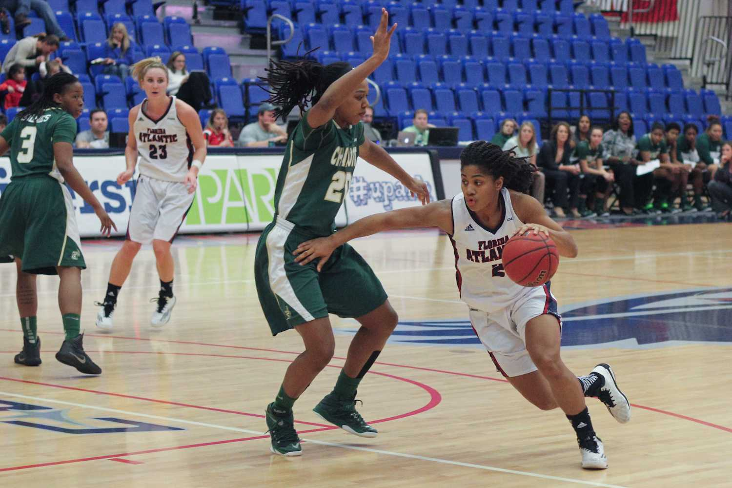 FAU guard Shaneese Bailey (2) drives toward the basket around Charlotte forward Kira Gordon. Bailey finished with 10 points in a 71-68 win over Charlotte on Jan. 29.