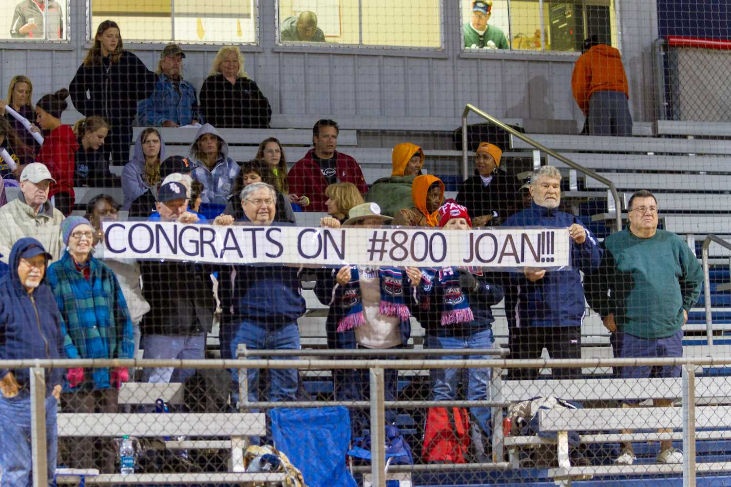 Fans gather to congratulate head coach Joan Joyce after her 800th career win.
