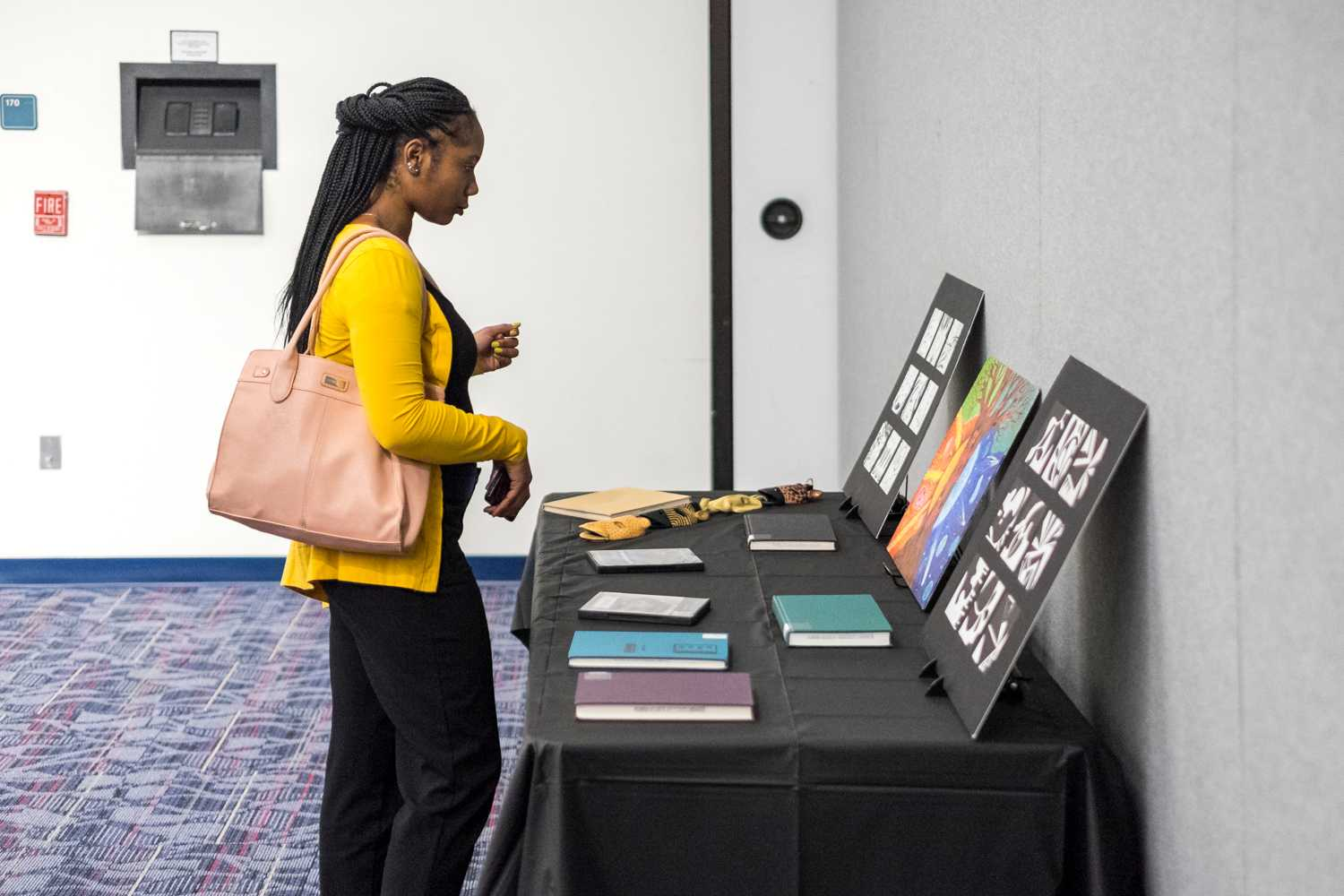 Shamariah Reneau, junior in elementary education, examines the art thats on display during House of Black Culture on Feb. 12th.