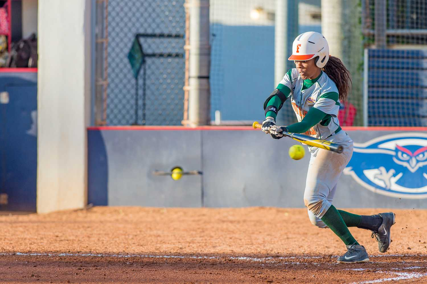 Center fielder Whitney Farris (13) runs into a bunt that resulted in an out in the bottom of the first.