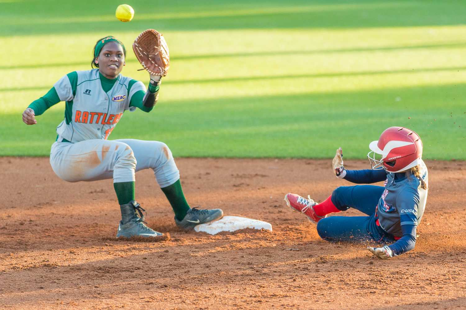 Christina Martinez (4) slides into second base for a steal.