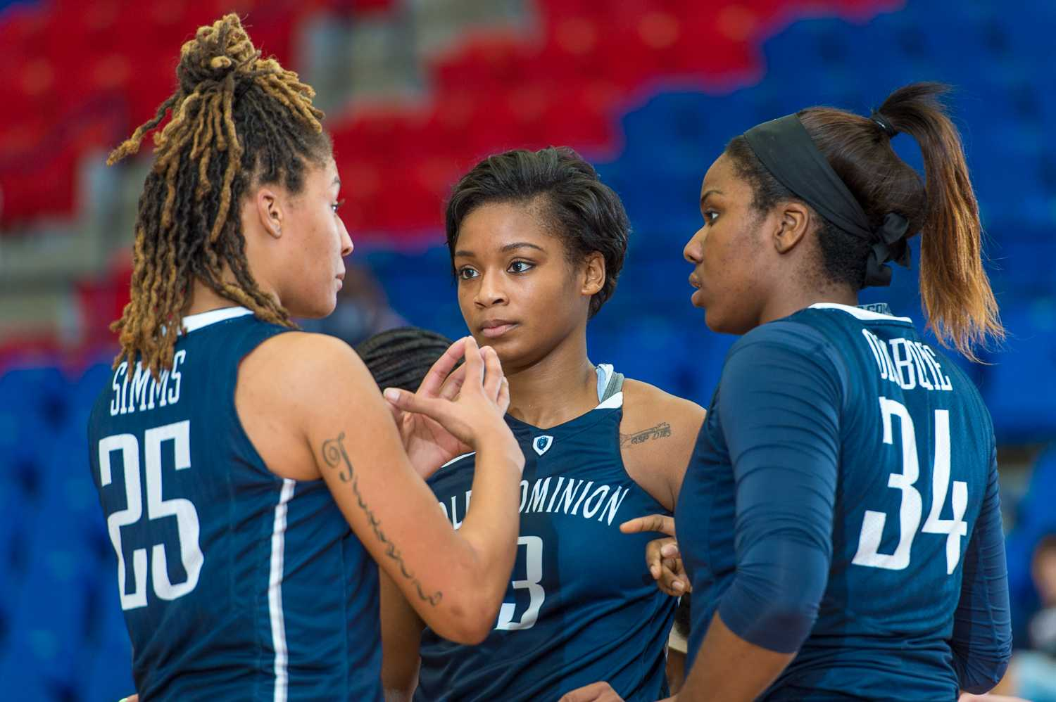 Jennie Simms (25) Chelisa Painter(3) and Odegua Oigbokie (34) of Old Dominion huddle during a break in play.
