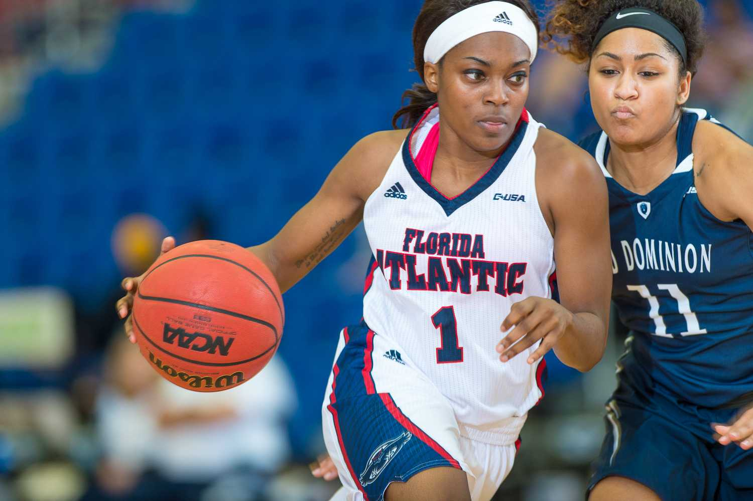 Aaliyah Dotson (1) of FAU drives to the paint around Ashley Betz-White (11) of ODU.