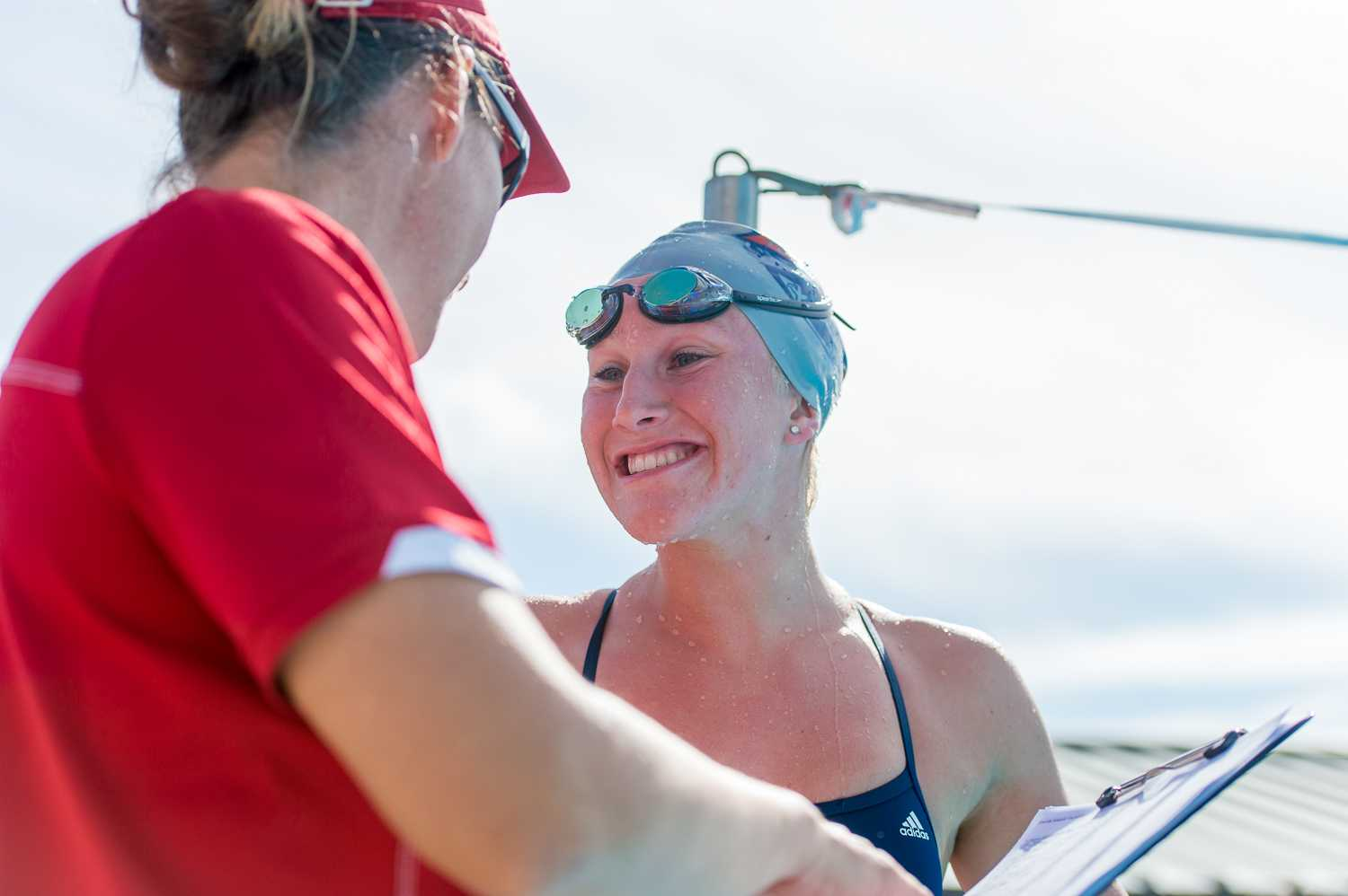 FAU's Abbey King celebrates with her coach after winning the women's 1000 yard freestyle event with a time of 10:27.01.