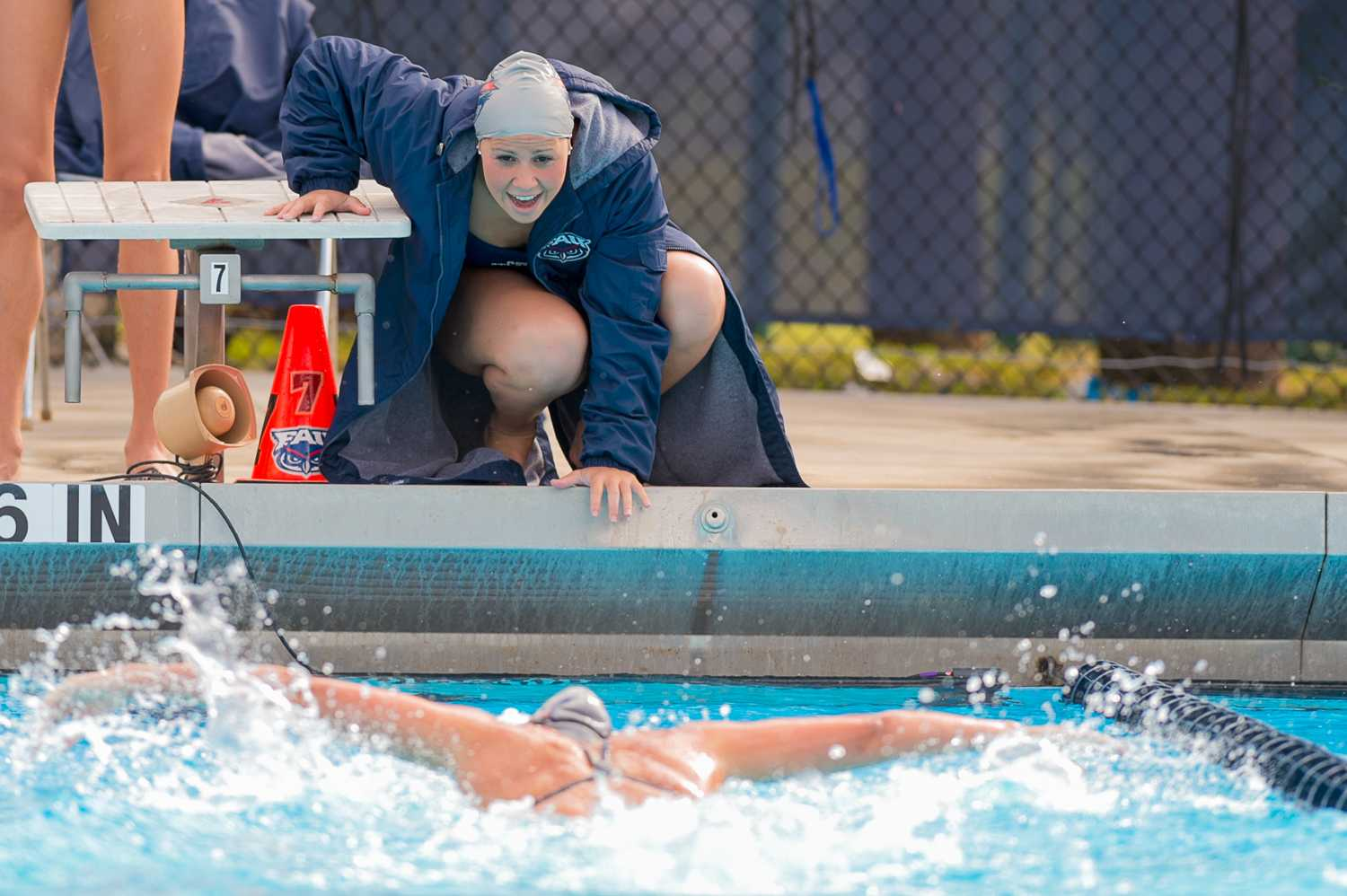 Sahra El-Hamaki cheers on her teammate in the final stretch of the women's 200 yard butterfly.