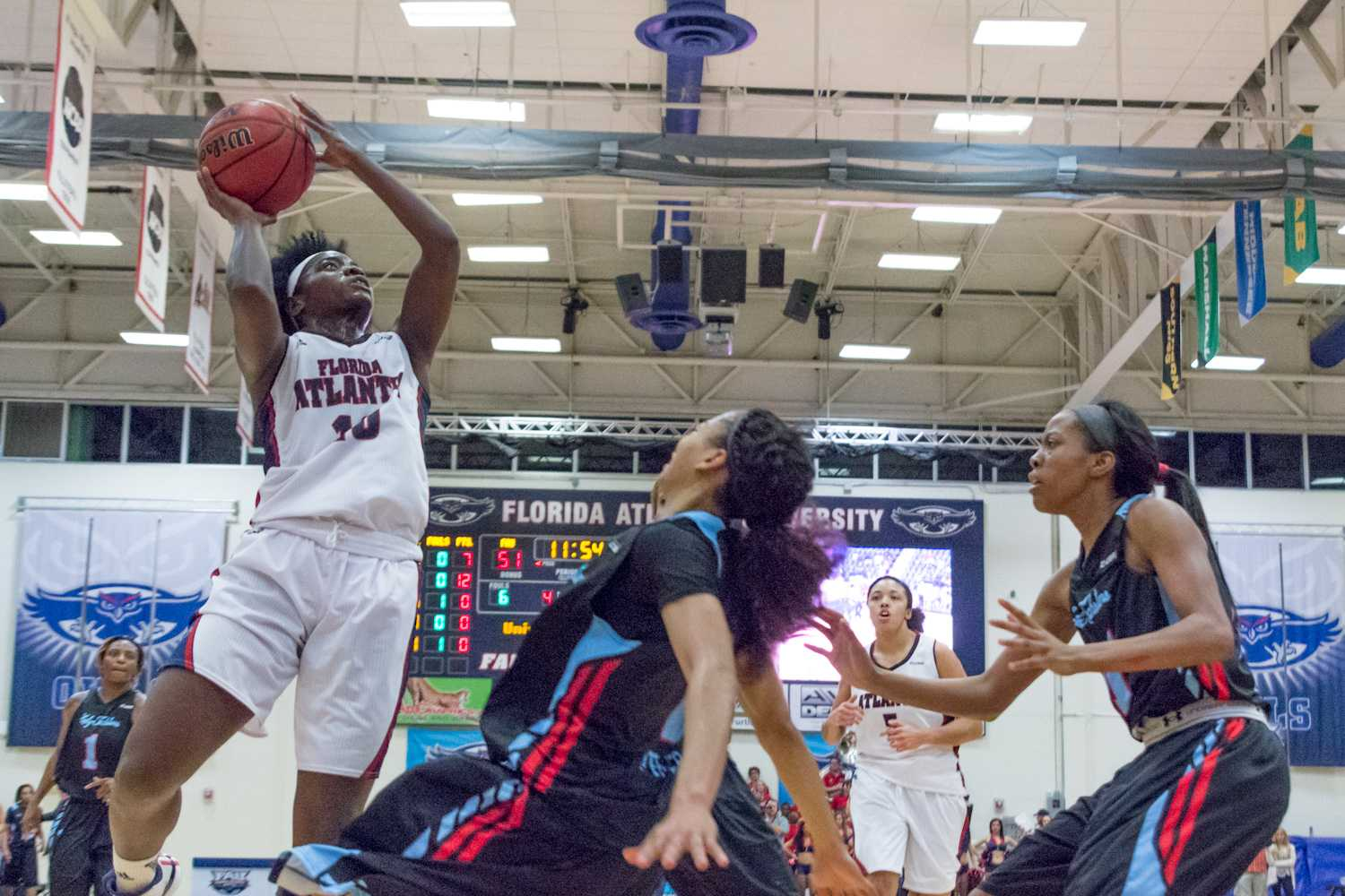Morgan Robinson (10) lays the ball in. Robinson put up 18 points on the night.