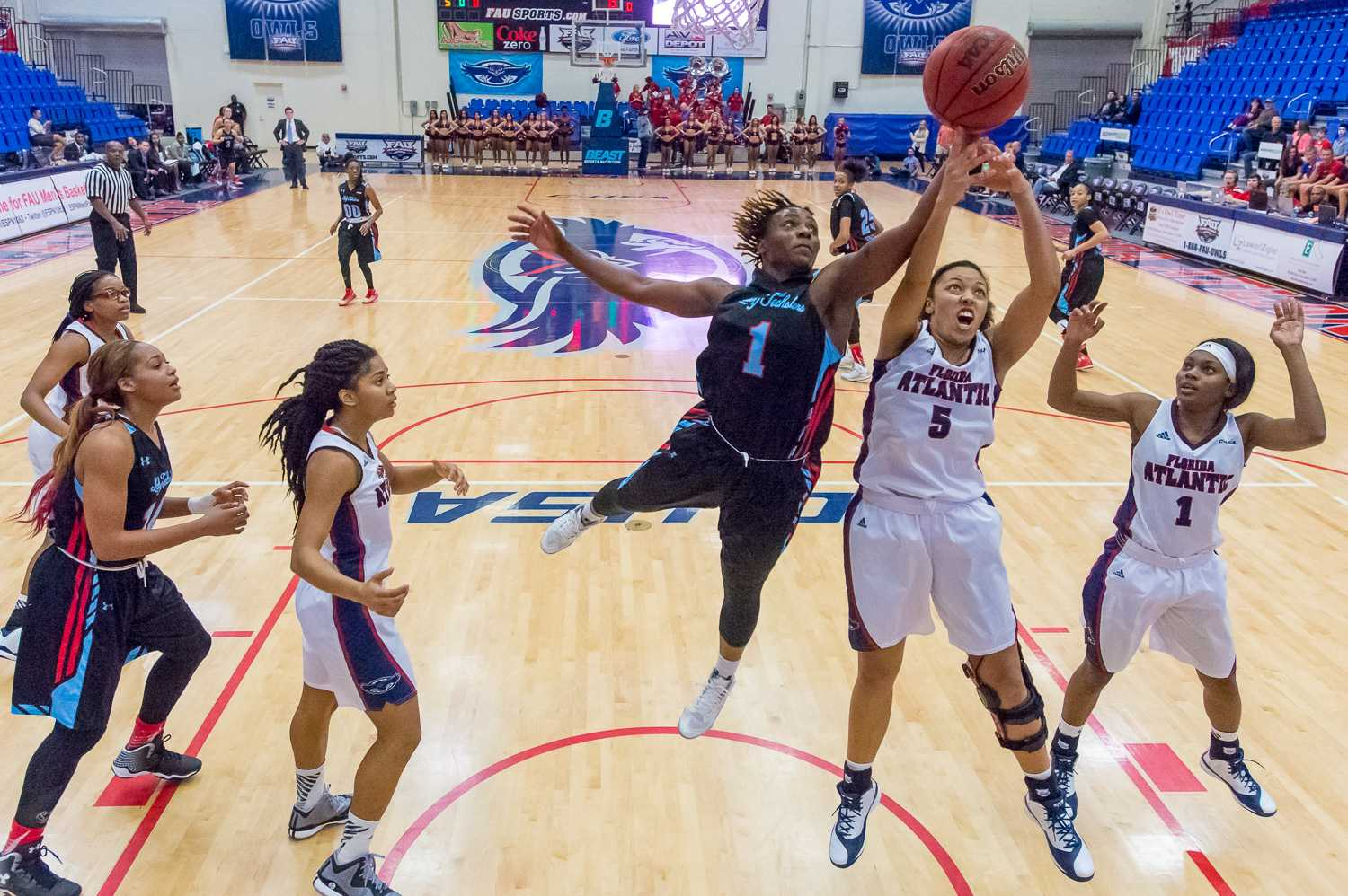 Owls' guard Raven Doyle (5) fights for a rebound with Kelia Shelton (1) of the Lady Techsters.