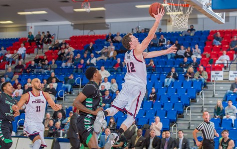 Trapp (12) attempts a layup in the first half of play.  He was 4-of-6 from the field and scored 10 points on the night.