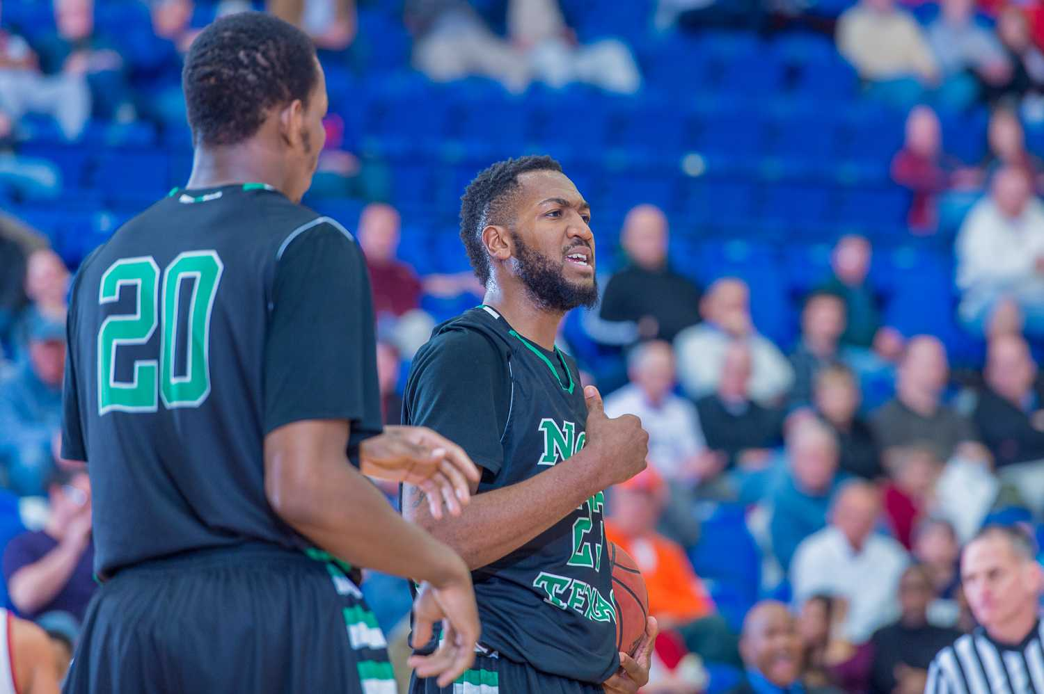 Williams (23) questions a ref on a call in the second half.