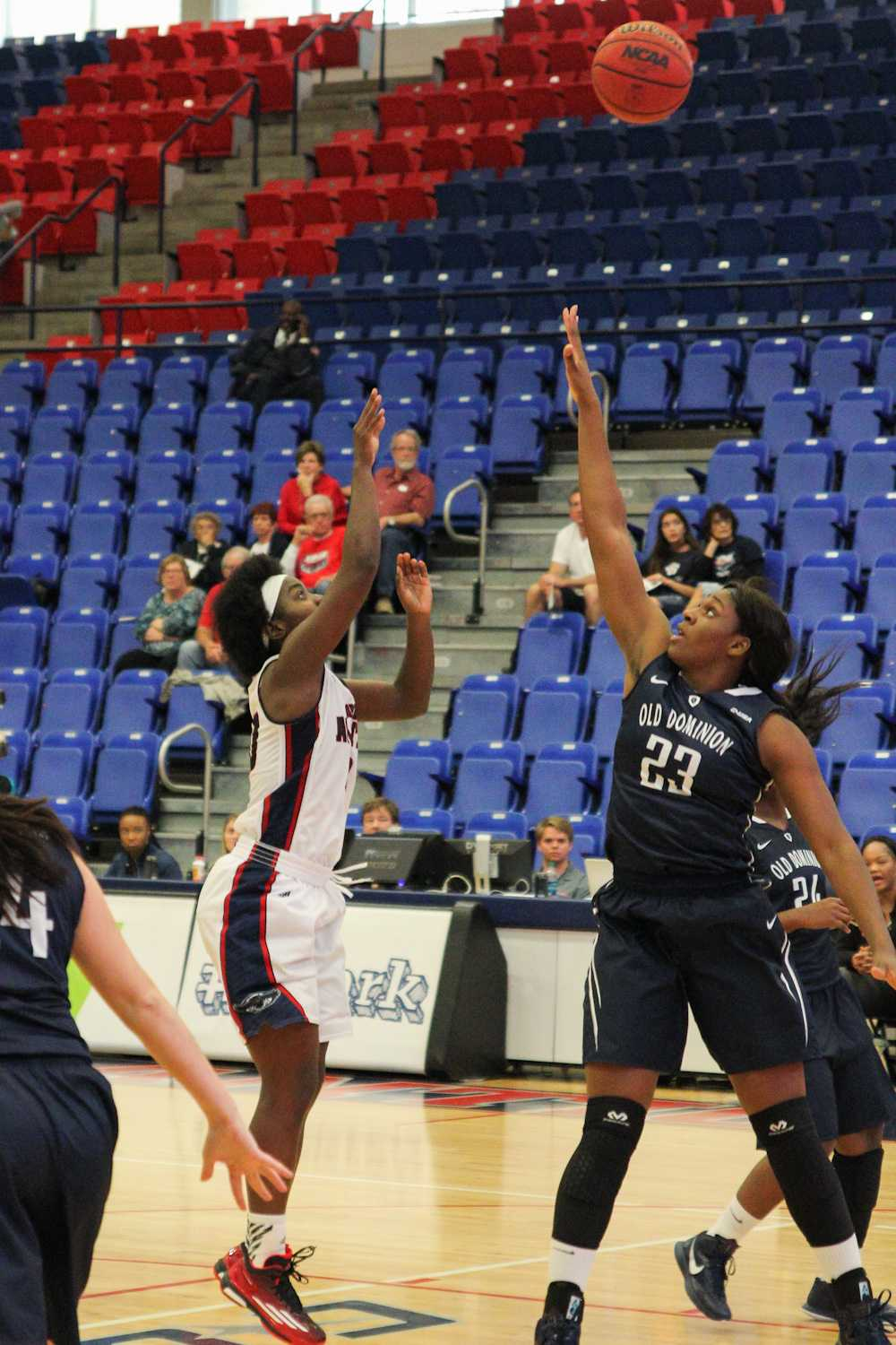 Morgan Robinson (10)  of the FAU Owls attempts a jump shot over Ije Ajemba (23) in the first half. Robinson shot 2-for-10 on the night.