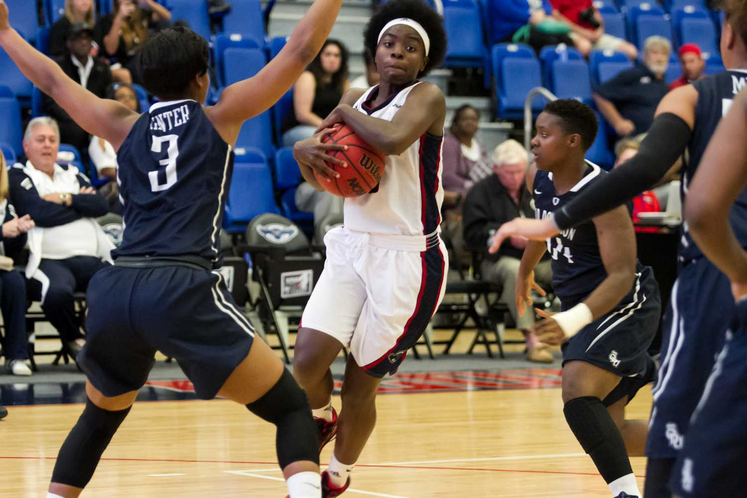 FAU guard Morgan Robinson moves towards the basket around ODU forward Chelisa Painter. The junior from Longwood, Fla. scored six points on the night.