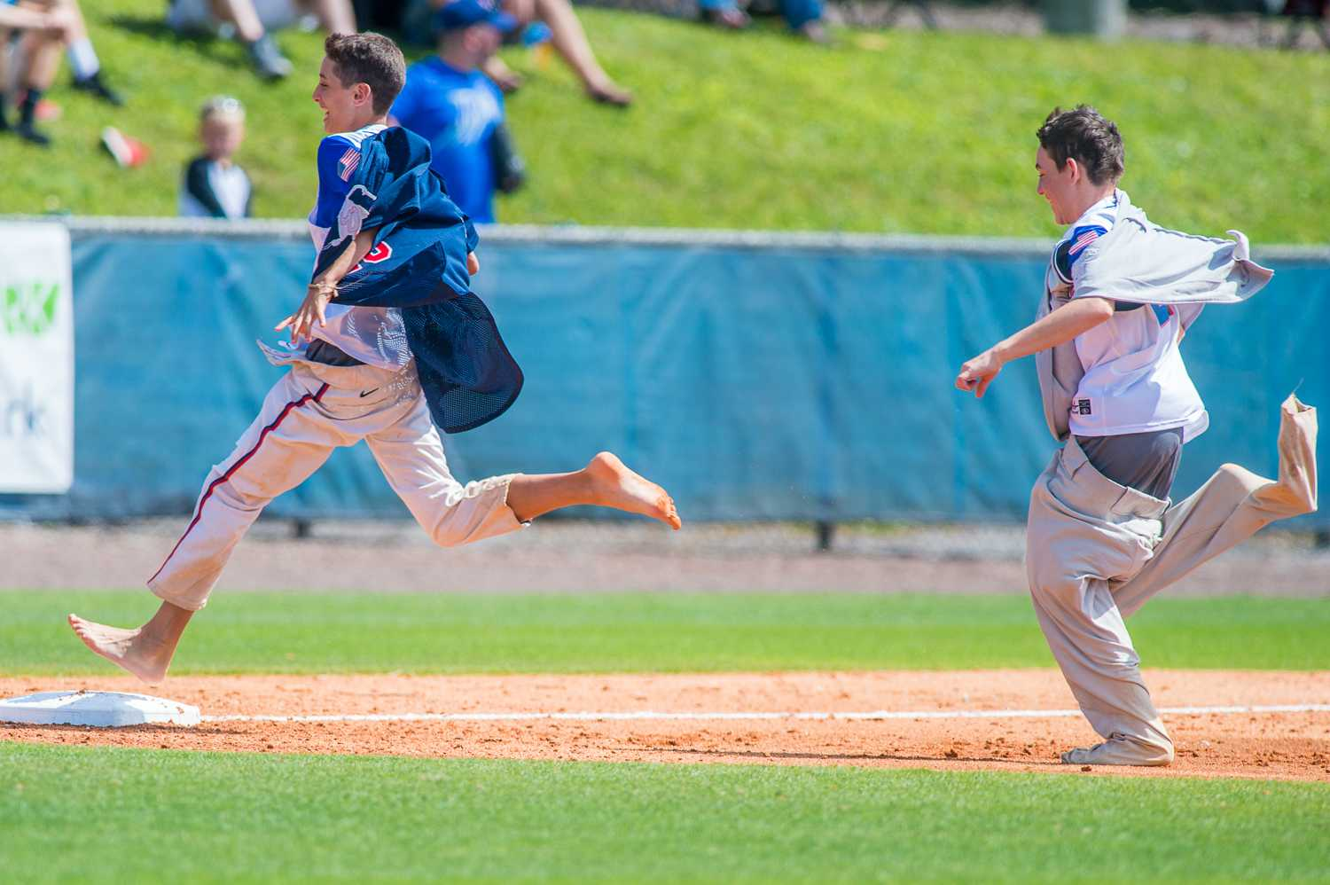 """Two young FAU fans compete in the """"run the bases"""" challenge in between innings."""