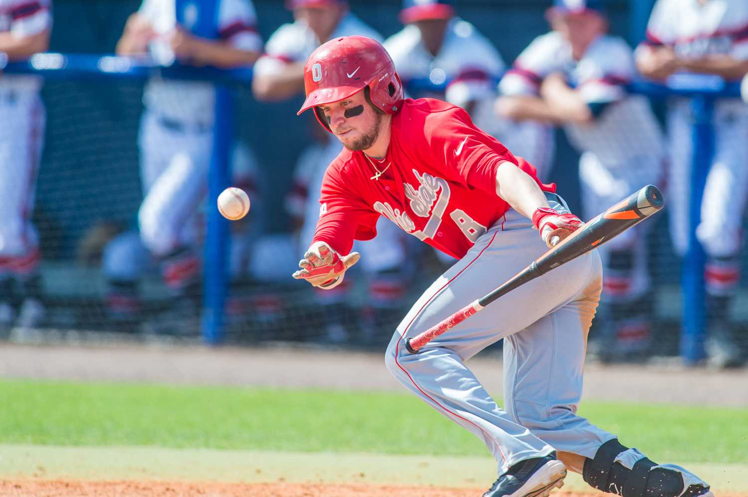 Troy Montgomery (8) of the Ohio State Buckeyes bunts in the eighth inning.  He was thrown out by pitcher Reily Monkman (21).