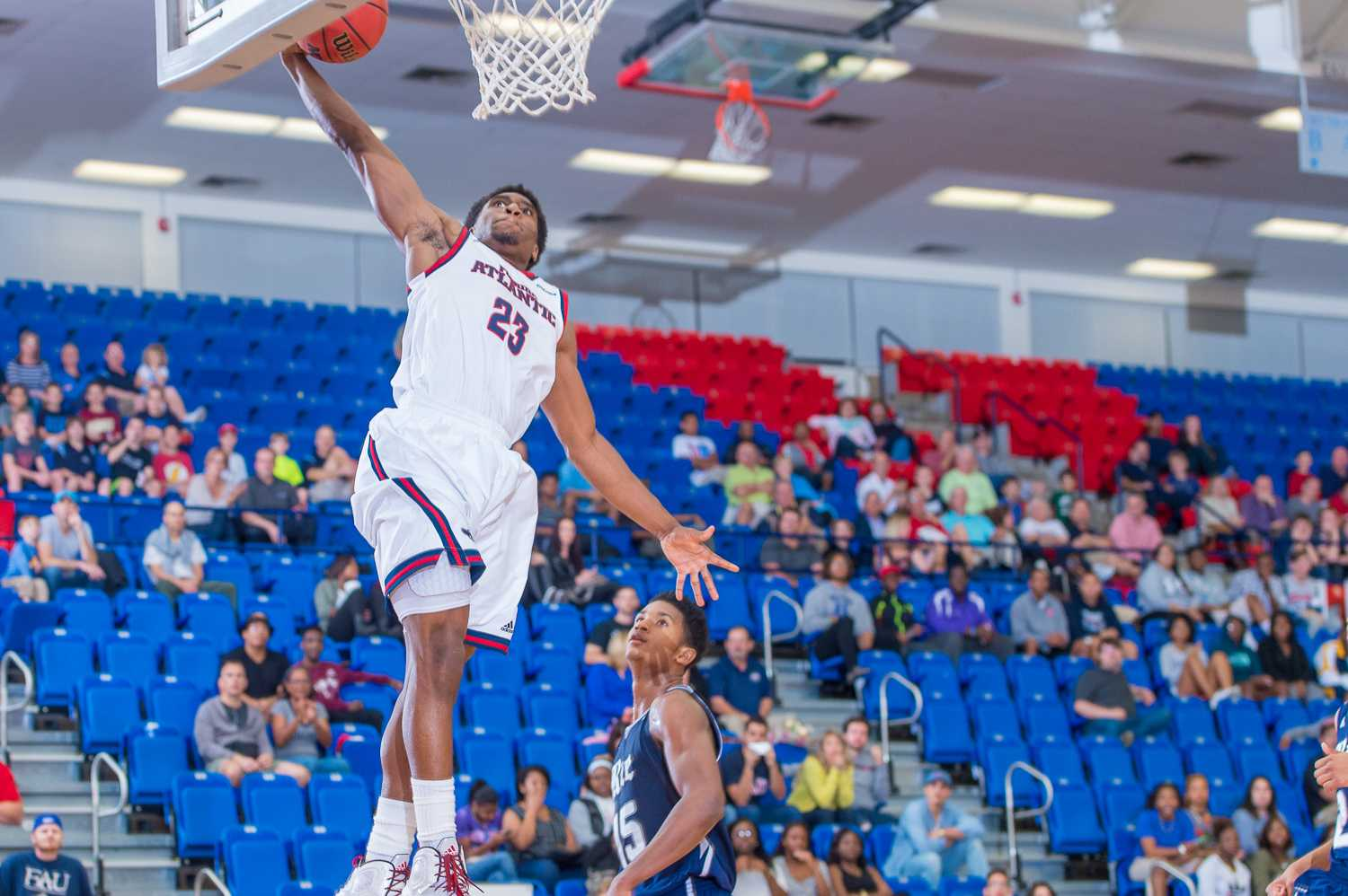 Poole (23) throws down a successful one-handed dunk in the first half of play.  Poole was FAU's highest scorer with 22 points on the night.