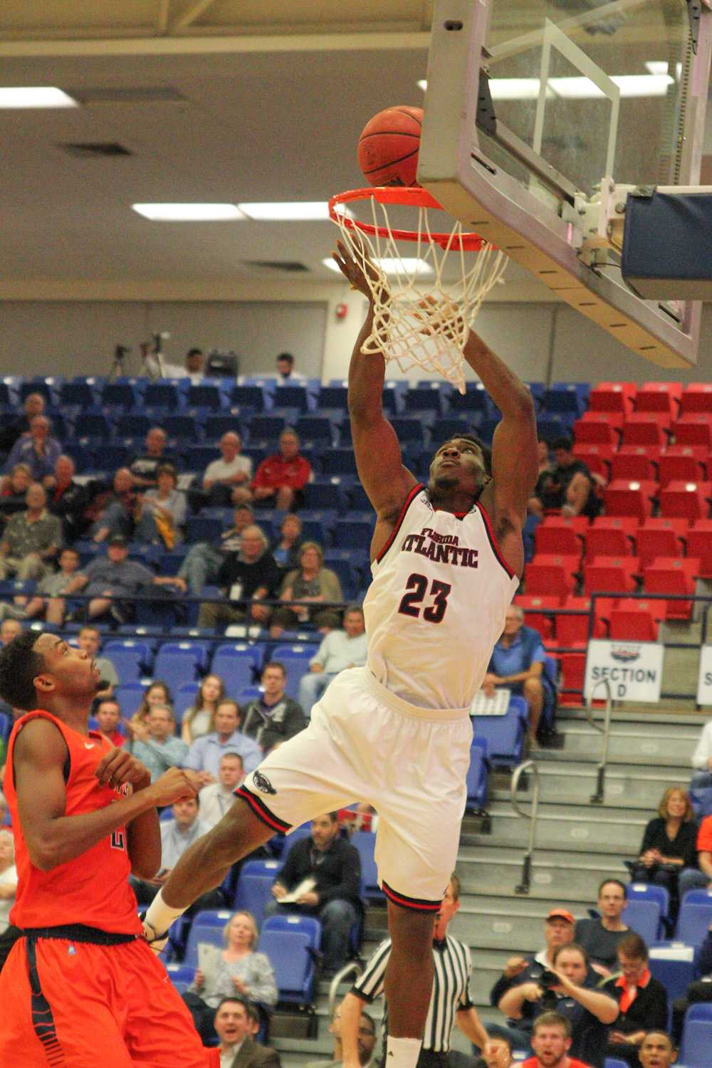 Solomon Poole (23) goes in for a shot during the game against UTEP.