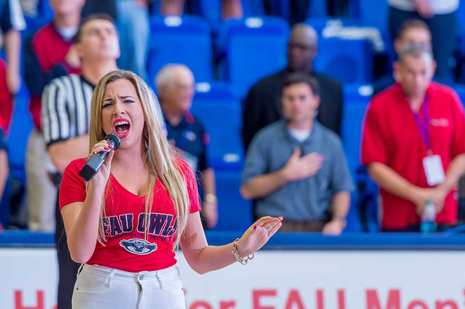 FAU student Jennifer Ashley sings the national anthem prior to the tip-off of the FAU Men's Basketball game against UTEP on Thursday night Feb 5.
