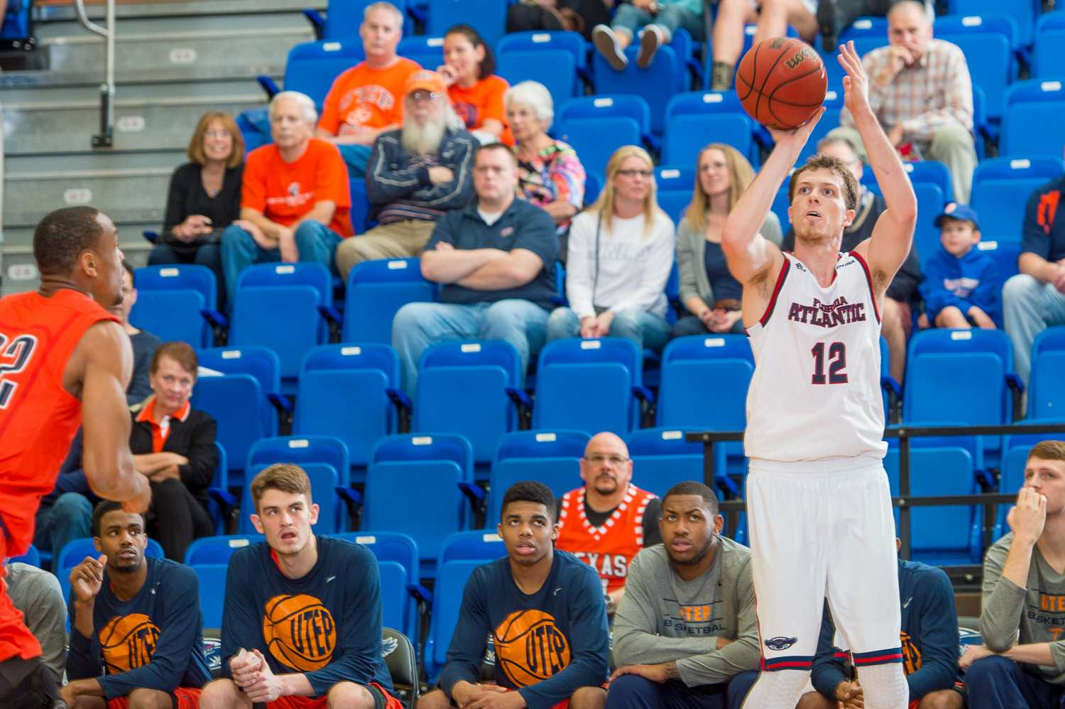 Jackson Trapp (12) of the FAU Owls attempts a three pointer in the first half of play against UTEP.  Trapp shot 1-for-4 from the 3-point line and scored six points on the night.