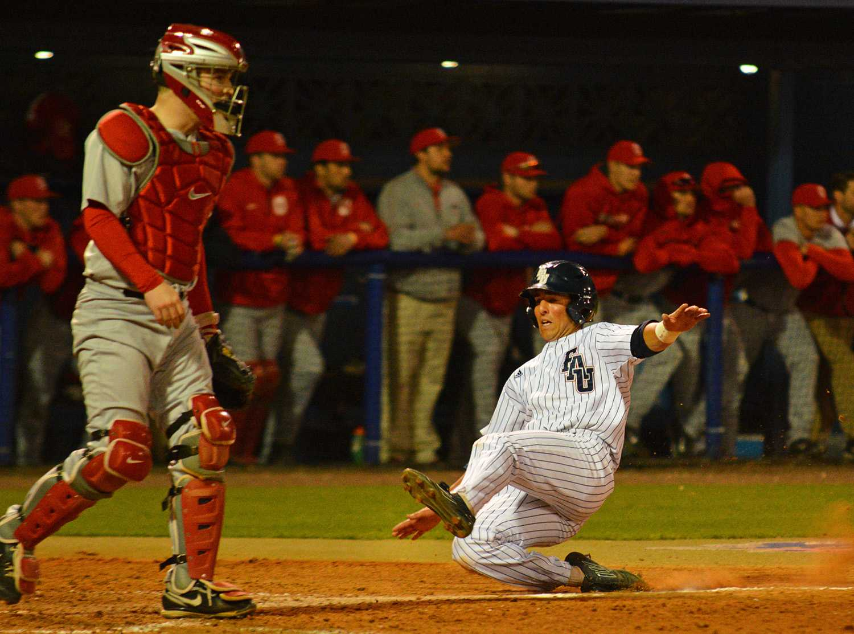First baseman Brett Lashley (12) scores one of FAU's two runs against the Buckeyes in Friday's loss.