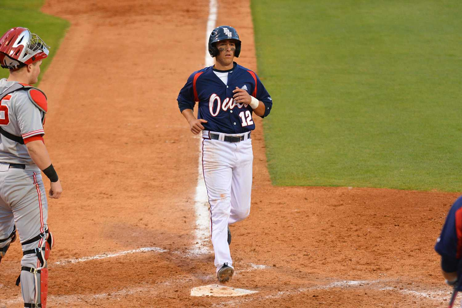 First baseman Brett Lashley runs into home to help push the Owls past the Buckeyes 7-0 during the Saturday matchup.