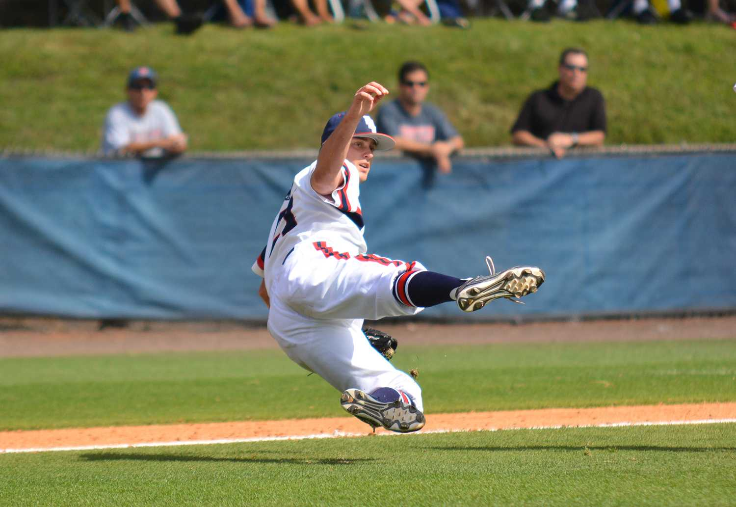 Relief pitcher Riley Monkman (21) follows the play as falling after throwing the ball to first base off of a bunt.
