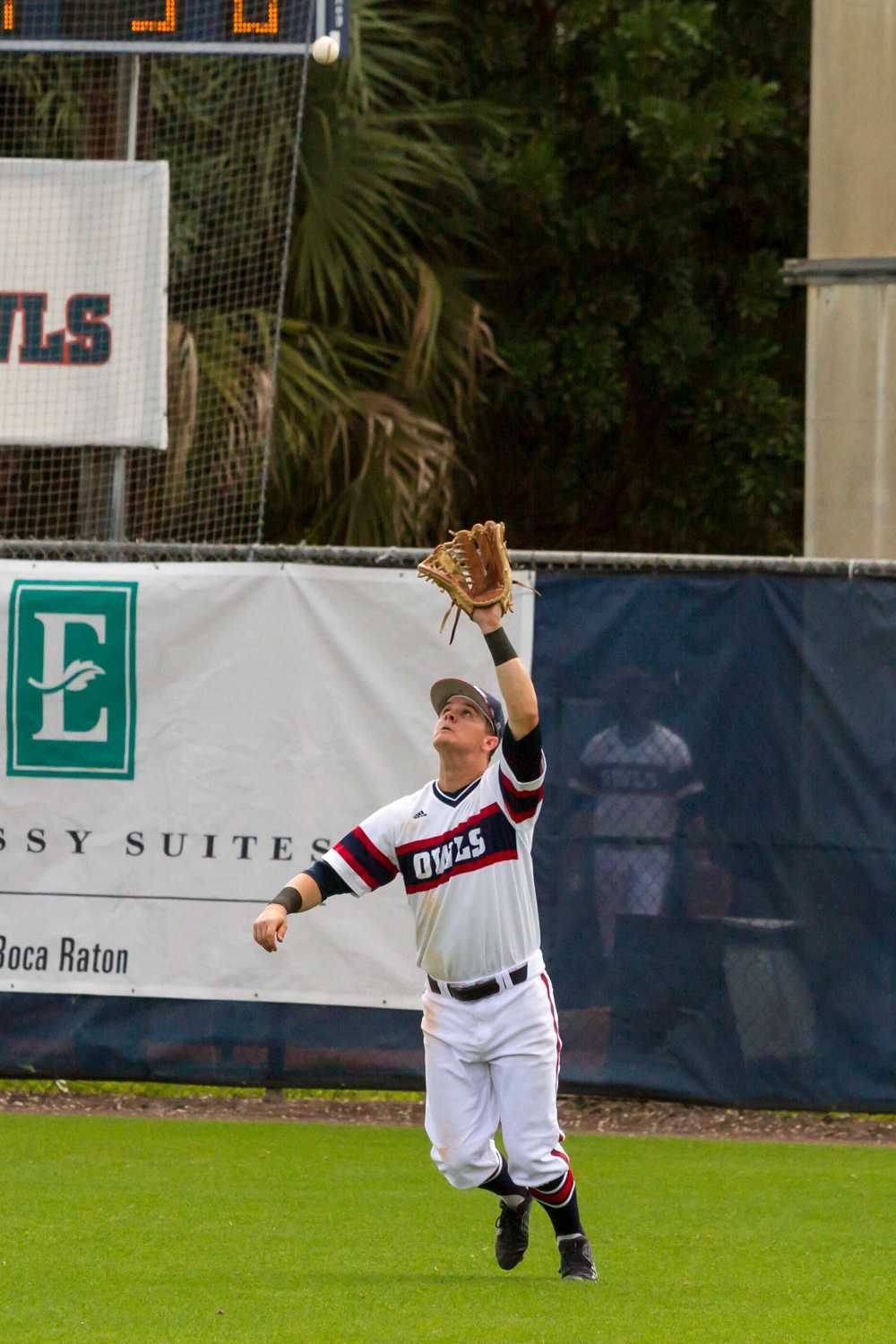Junior right fielder Brendon Sanger (23) waits underneath a ball to make a catch. He had two hits and four at bats.