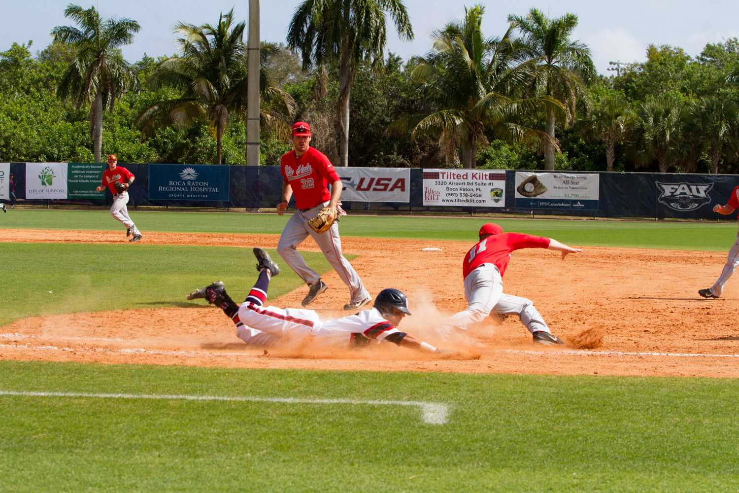 Sophomore Stephen Kerr (6) slides into first safely after an Ohio State error.