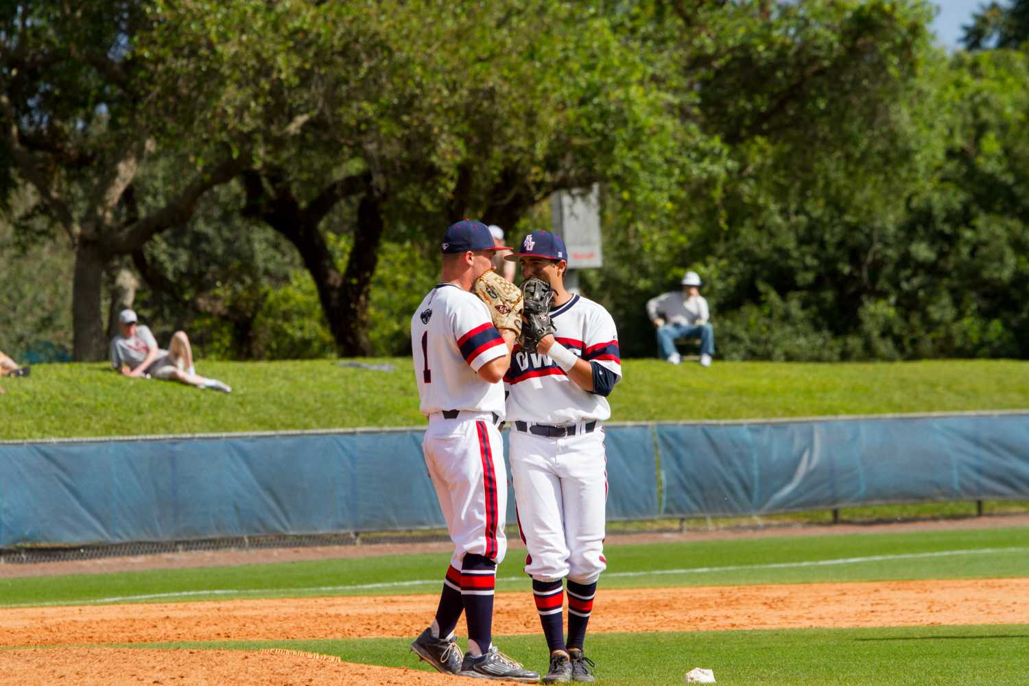 Senior pitcher Bo Logan (1) talks with a teammate in the top of the ninth inning. Logan had the save in The Owls' 2-1 win against The Buckeyes.