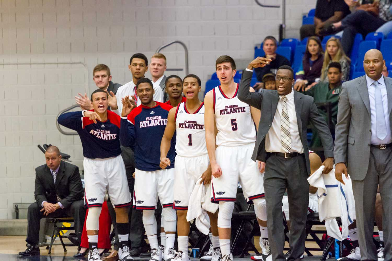 Members of the FAU basketball team celebrate after a made 3-point field goal in the first half. The team hit seven of its 16 3-point attempts in the game.