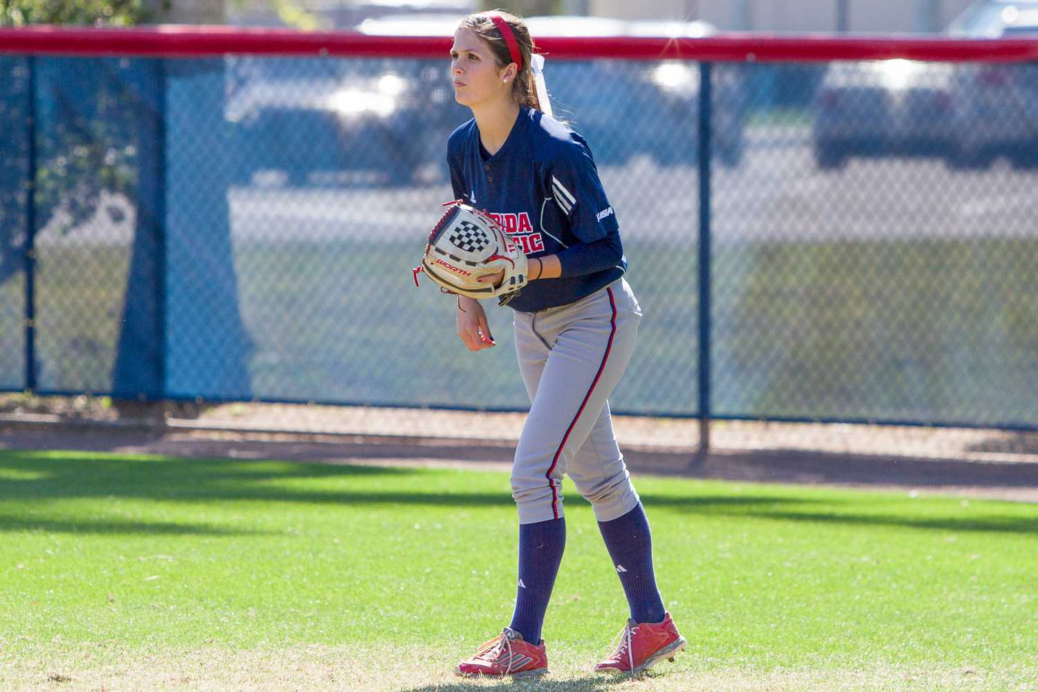 Sophomore outfielder Delaney Rickey waits for a pitch to be delivered.  Rickey had four putouts in the game.
