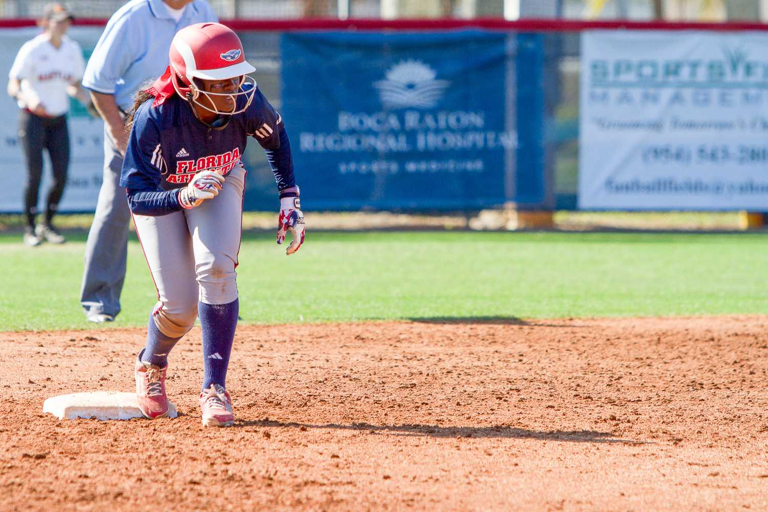 Junior infielder Carnesha Thompson prepares to lead off second base. Thompson went 2 for 4 and scored one of the Owls' six runs.