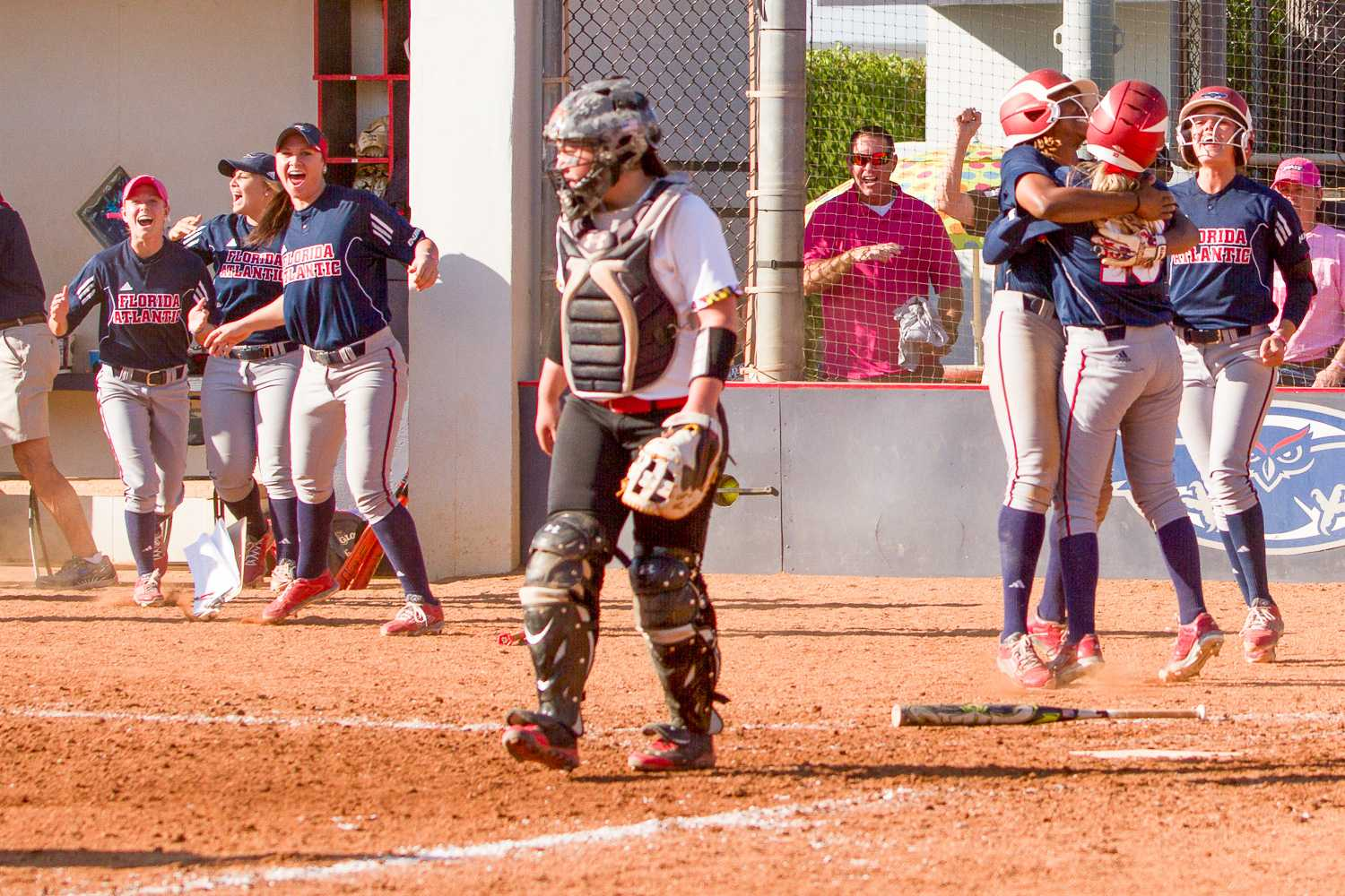 enior outfielder Lindsay Shell is rushed by teammates after scoring the game winning run on an errant throw to first base. The Owls have now won eight in a row, and have come from behind in two of their nine victories this season.