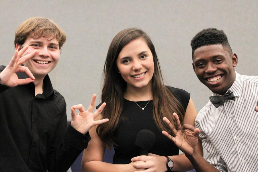 Governor candidates Onur Basman, freshman, international relations & political science major and Akeem Edwards, senior, psychology major show their owl pride with Owl Radio station manager Gabby Alvarado, senior, international business major.  Jessica Wilkerson | Contributing Photographer