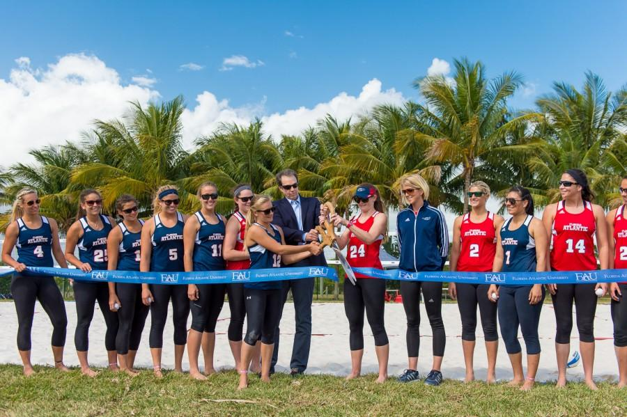 FAU+sand+volleyball+captains+Natalie+Fraley+%2812%29+and+Mandy+McIntosh+%2824%29+are+joined+by+FAU+President+John+Kelly+to+cut+the+ribbon+to+officially+open+the+new+sand+volleyball+courts.++Max+Jackson+%7C+Photo+Editor