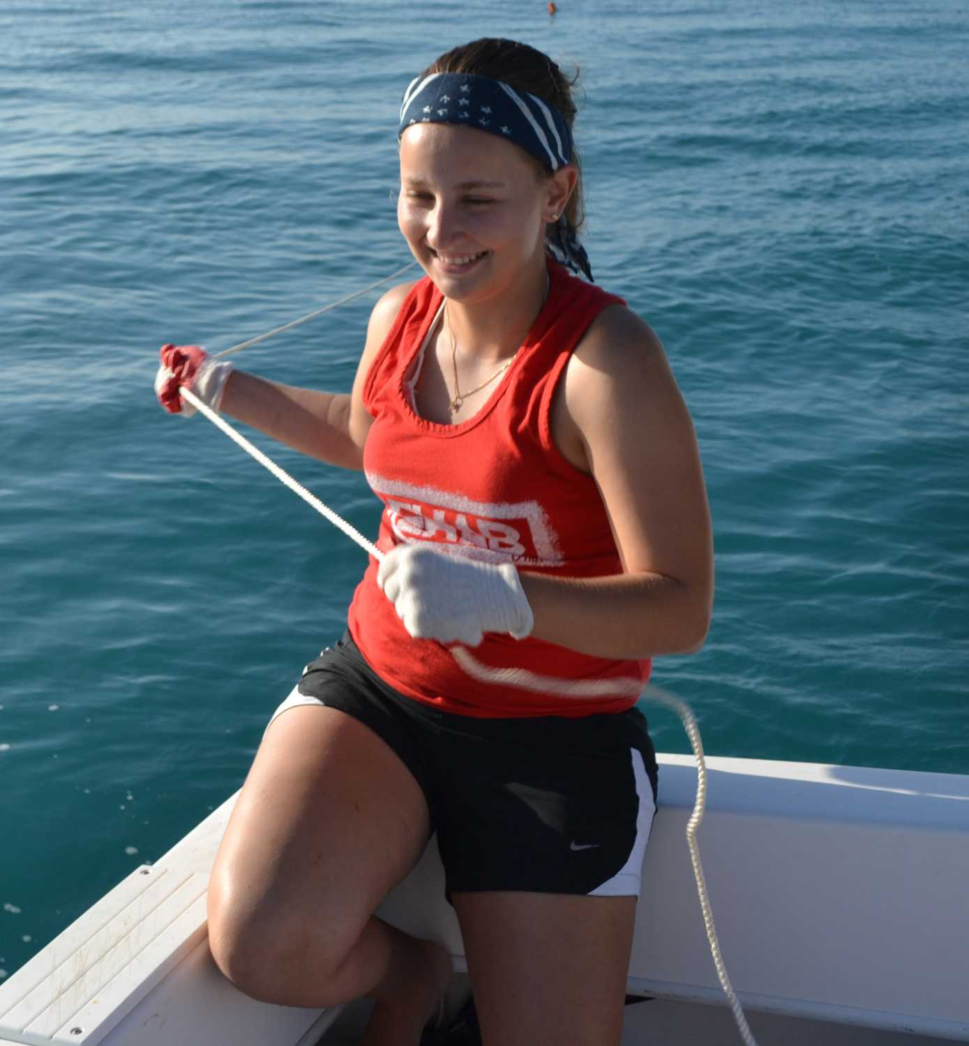 Eloise Cave holds a line on the FAU research boat. Photo courtesy of Stephen Kajiura