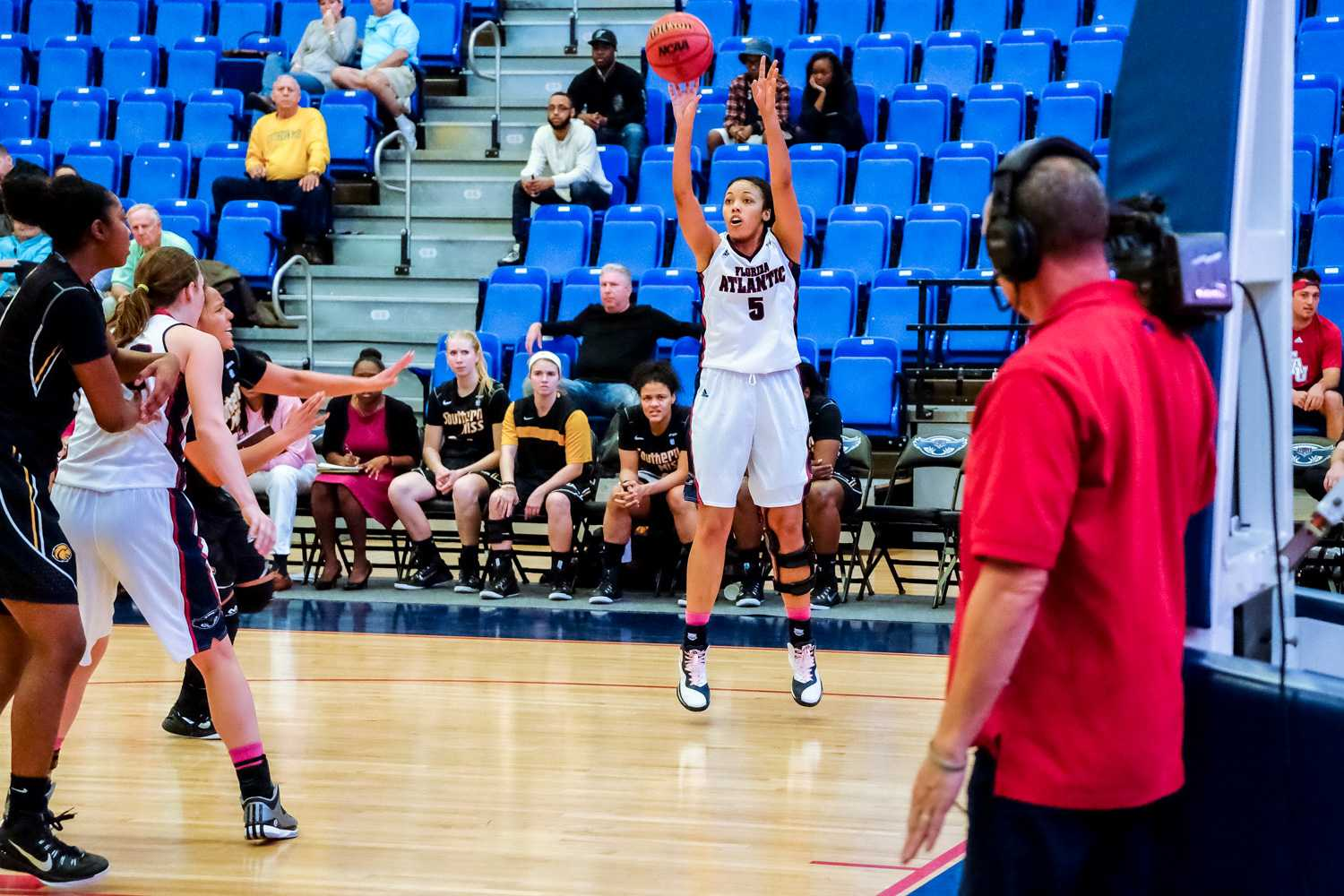 Raven Doyle (5) shoots a two pointer.