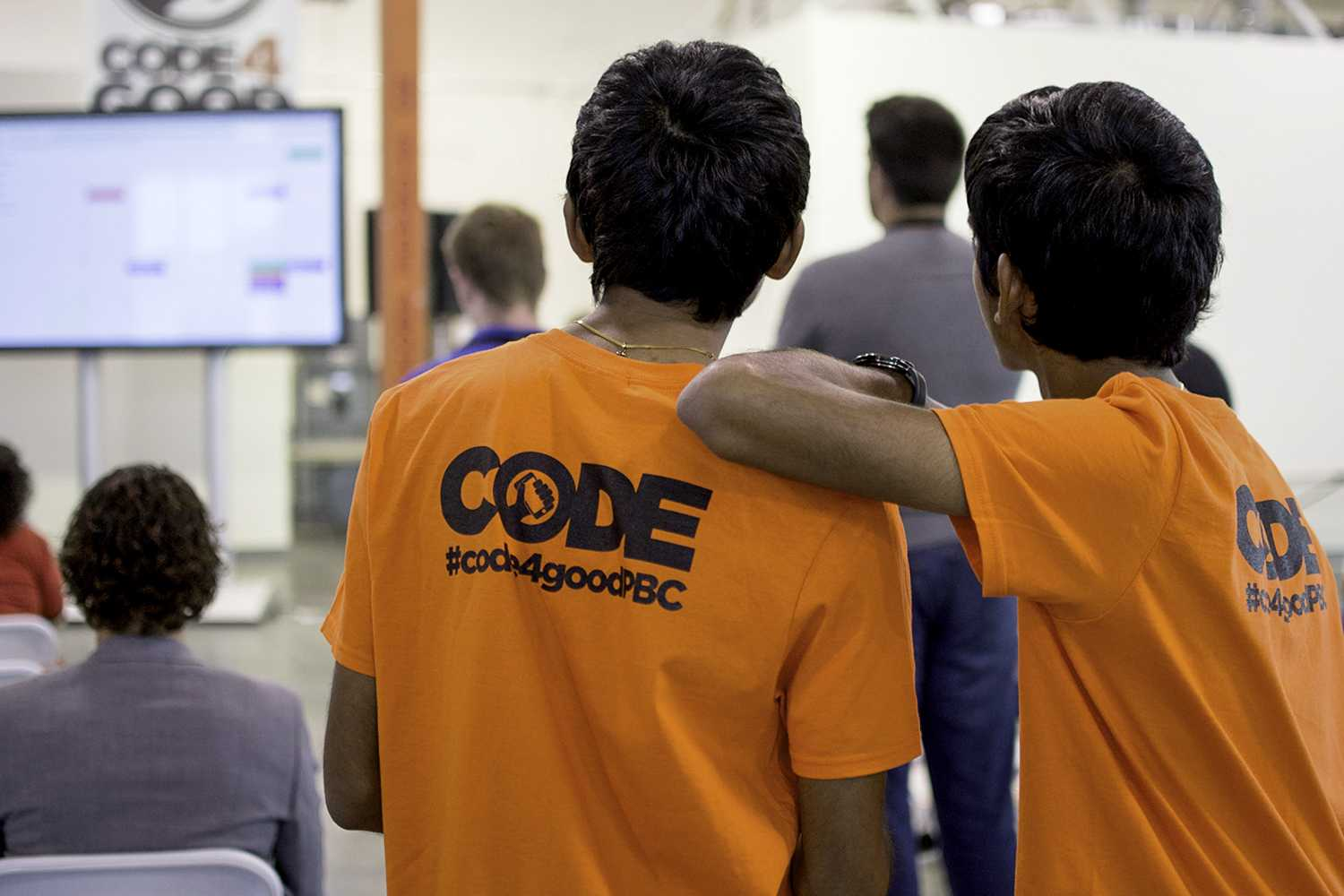 Brothers competing in FAU's Code4Good hackathon watch as their opponents give their presentations to the judges. The event lasted from March 28-29 and was run by Code4Good Palm Beach County.