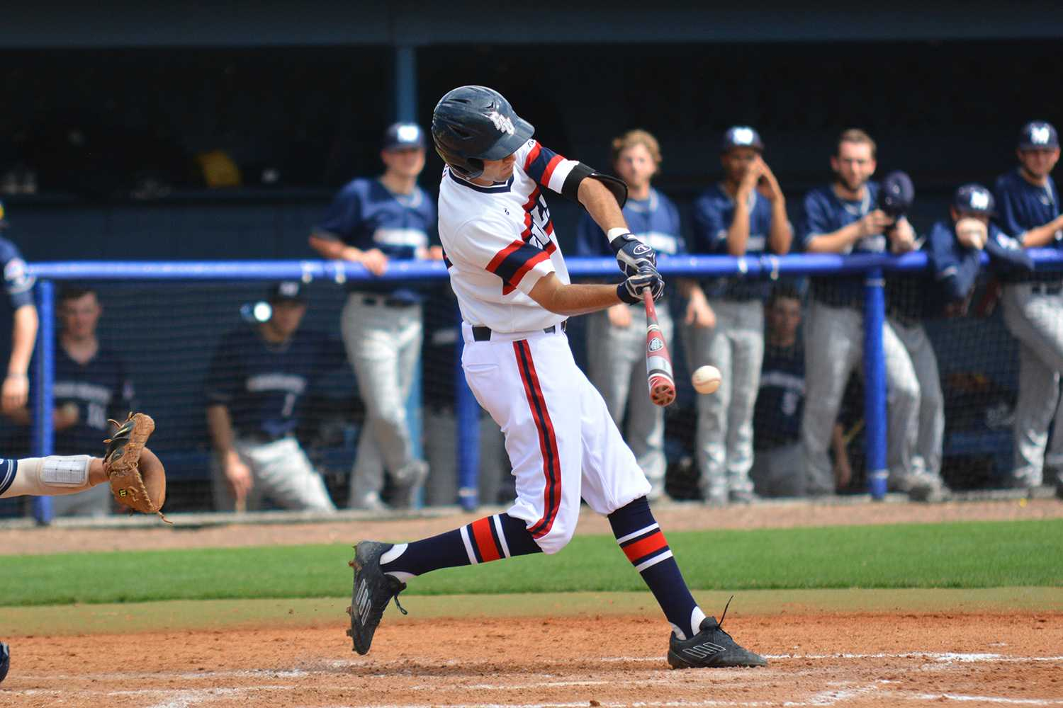 Shortstop CJ Chatham makes contact for his only hit of the second game in the series to add to FAU's 13 hits in the game.
