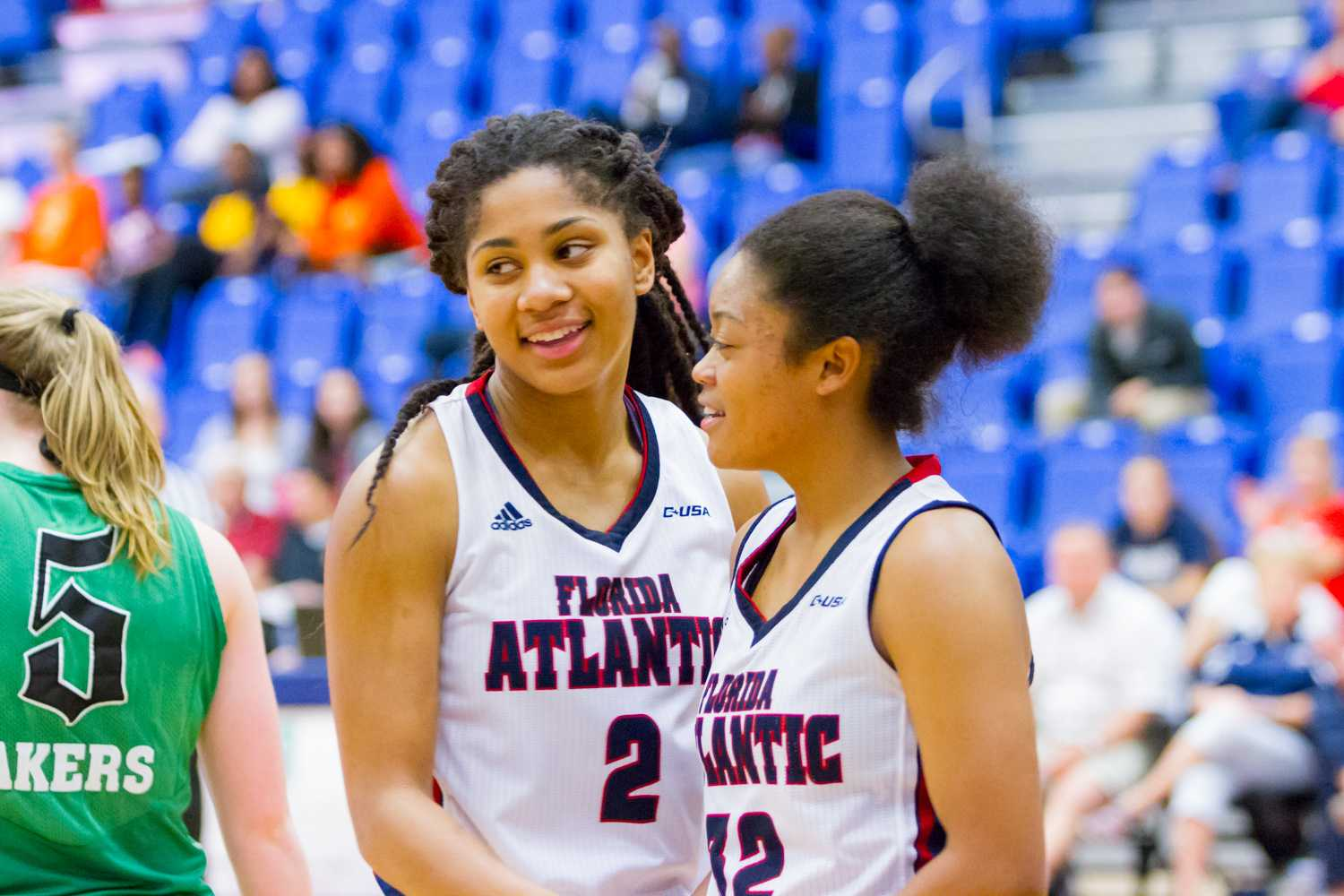 Guards Shaneese Bailey (2) and Malia Kency (32) smile during a dead ball.