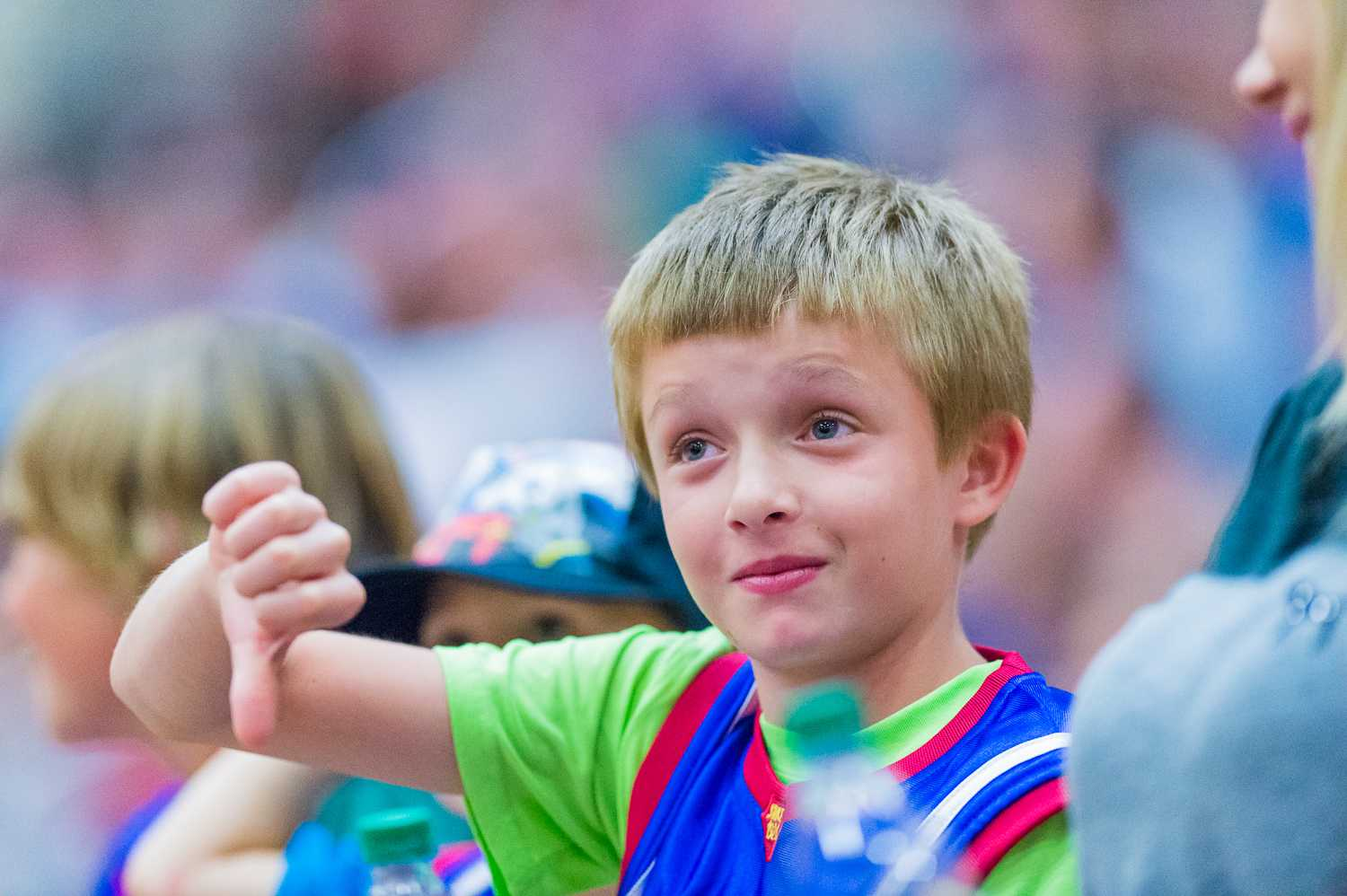 A young Globetrotter fan gives the referee a thumbs down after a bad call.