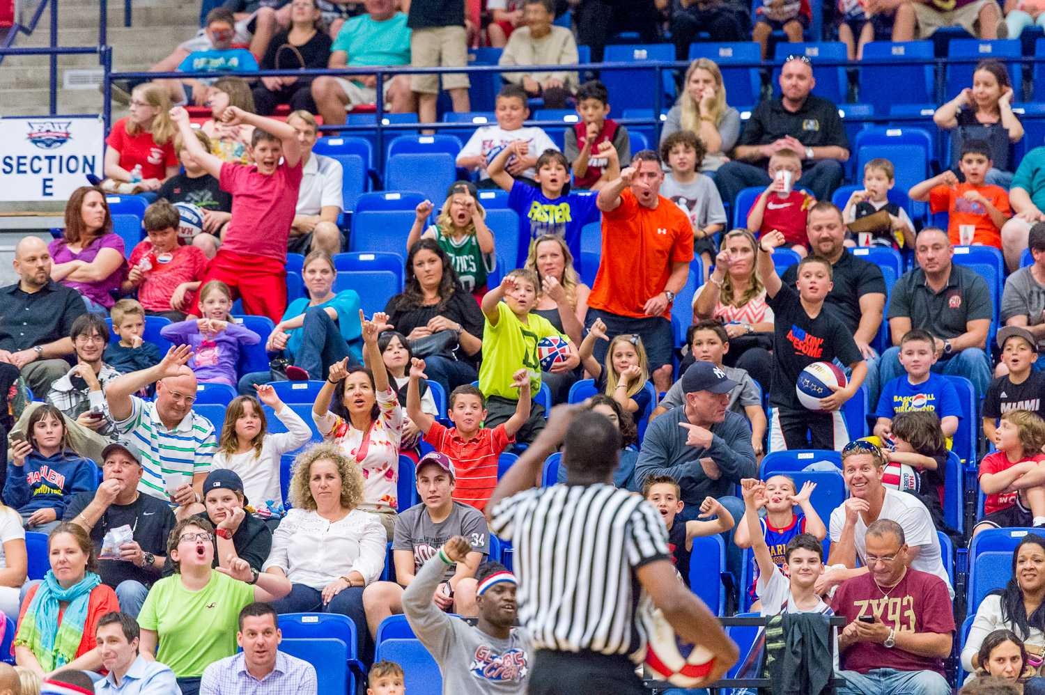 Globetrotter fans boo the referee after a series of bad calls.