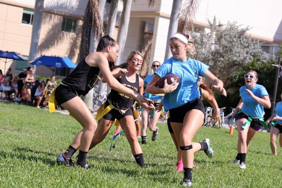 Phi Mu member tries to break past Alpha Xi Delta members during the Greek Games on Friday March 20th.
