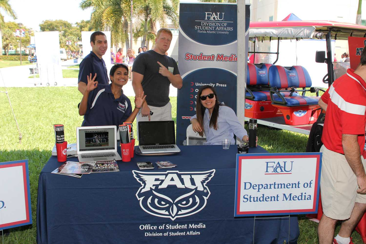Members of different student media branches representing the Department of Student Media at FAU's Spring Campus Day on Friday March 20th.
