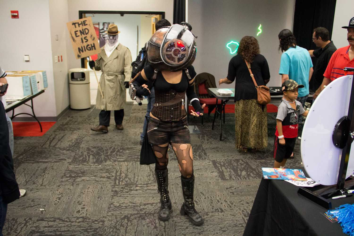 Student Ariel Cofino cosplaying as a Big Sister from video game BioShock 2, while George Alonso stands in the back as Rorschach from the graphic novel Watchmen, spreading his doomsday message.