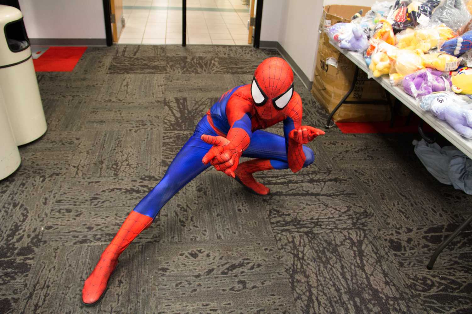 Henry Evans stands ready to attack Electro or Venom as The Amazing Spider-Man.