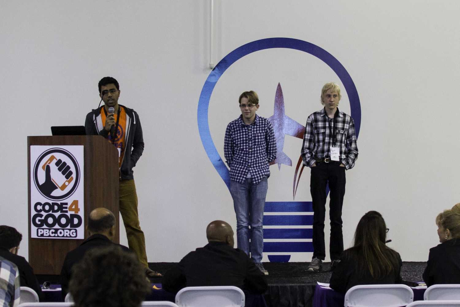 """First place winners: Aton, Rohan, and Kurt team """"TechGarage"""" give their 5 minute presentation to the judges. Photo by Alexis Hayward 