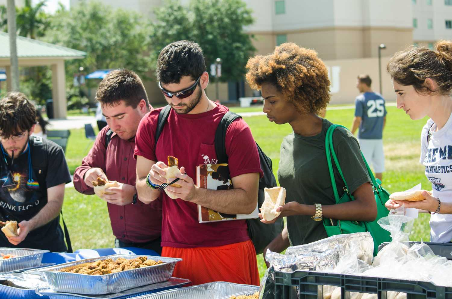 Students enjoying the free traditional food at the Israel Independence Day Carnival.